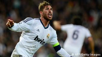 Real Madrid's defender Sergio Ramos celebrates after scoring during the UEFA Champions League semi-final second leg football match Real Madrid CF vs Borussia Dortmund at the Santiago Bernabeu stadium in Madrid on April 30, 2013. AFP PHOTO / JAVIER SORIANO (Photo credit should read JAVIER SORIANO/AFP/Getty Images)