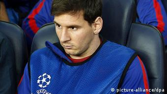 FC Barcelona's Argentinian striker Lionel Messi sits on the bench during the UEFA Champions League semi final second leg soccer match between FC Barcelona and Bayern Munich at Camp Nou in Barcelona, Spain, 01 May 2013. (Photo: EPA/ANDREU DALMAU)