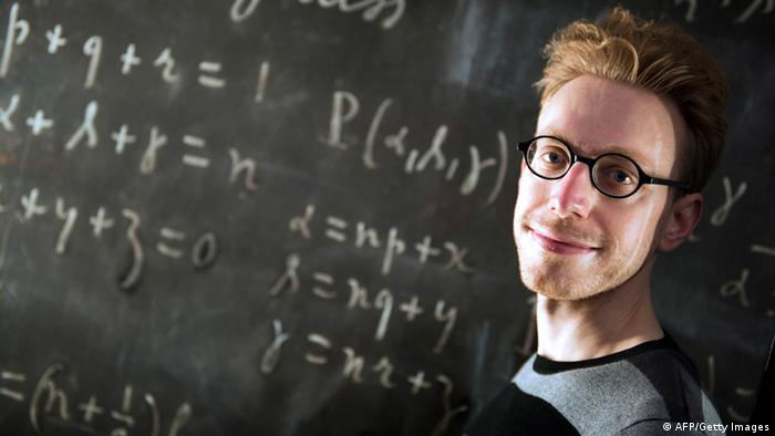 British writer, essayist and autistic savant Daniel Tammet poses on March 14, 2013, at the Palais de la Decouverte, a science museum in Paris, as part of the first Pi Day in France, a celebration commemorating the mathematical constant pi. Daniel Tammet holds the European record for reciting pi from memory to 22,514 digits in five hours and nine minutes on 14 March 2004. AFP PHOTO / LIONEL BONAVENTURE (Photo credit should read LIONEL BONAVENTURE/AFP/Getty Images)