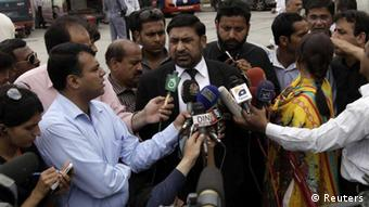 Prosecutor Chaudhry Zulfikar talks to journalists outside the anti-terrorism court (ATC) in Rawalpindi, in this file picture taken April 26, 2013. Zulfikar, the prosecutor investigating the 2007 assassination of former Pakistani Prime Minister Benazir Bhutto, one of the most shocking events in Pakistan's turbulent history, was shot dead on May 3, 2013, police sources said. Gunmen on a motorcycle pumped 12 bullets into Zulfikar as he left his home in Islamabad, the sources said. Picture taken April 26, 2013. REUTERS/Faisal Mahmood/Files (PAKISTAN - Tags: POLITICS CRIME LAW)