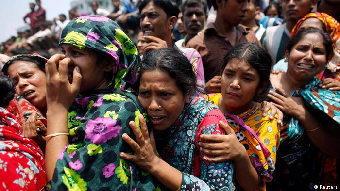 People mourn for their relatives, who are trapped inside the rubble of the collapsed Rana Plaza building, in Savar, 30 km (19 miles) outside Dhaka, in this file picture taken April 24, 2013. To match Special Report BANGLADESH-GARMENTS/ REUTERS/Andrew Biraj/Files (BANGLADESH - Tags: DISASTER BUSINESS TEXTILE)