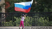epa03261667 A young Russia supporter waves the Russian national flag at the National Stadium in Warsaw Poland, 12 June 2012 before the Group A preliminary round match of the UEFA EURO 2012 between Poland and Russia. EPA/Rafal Guz POLAND OUT