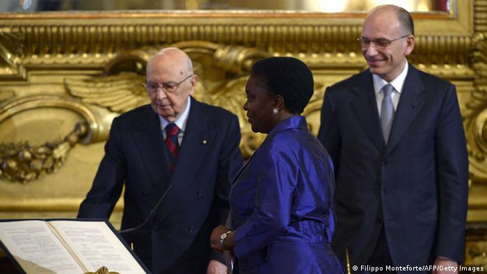 Italy's Integration minister Cecile Kyenge (C) stands in front of Italian President Giorgio Napolitano (L) during the swearing in ceremony in Rome of the new government of Prime Minister Enrico Letta (R) on April 28, 2013. Italy's new coalition government was sworn in on Sunday, bringing fresh hope to a country mired in recession after two months of bitter post-election deadlock watched closely by European partners. AFP PHOTO / FILIPPO MONTEFORTE (Photo credit should read FILIPPO MONTEFORTE/AFP/Getty Images)