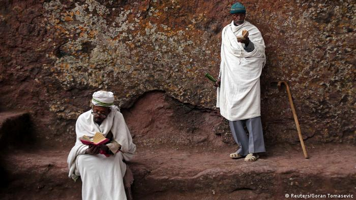 Orthodox Christians pray outside of one of 11 monolithic rock-cut churches, ahead of Orthodox Easter in Lalibela May 4, 2013. REUTERS/Goran Tomasevic (ETHIOPIA - Tags: RELIGION SOCIETY)
