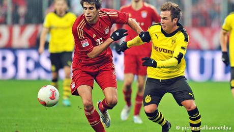 A file picture dated 01 December 2012 shows Munich's Javi Martinez (L) in action against Borussia Dortmund's Mario Goetze (R) during the German Bundesliga soccer match between FC Bayern Munich and Borussia Dortmund in Munich, Germany. (Photo via EPA/MARC MUELLER)
