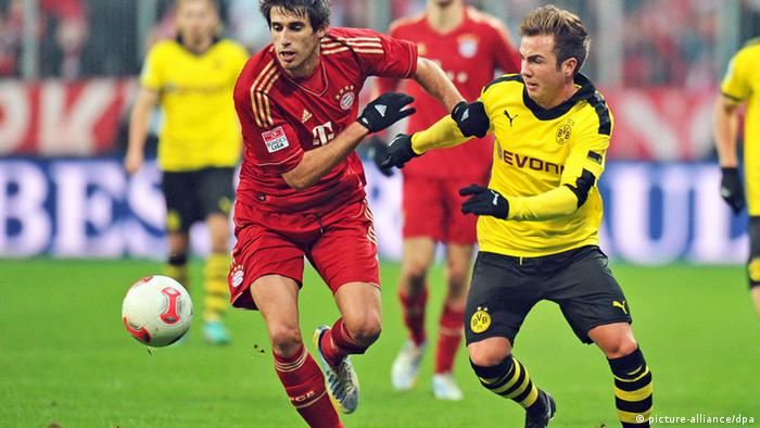 epa03684269 (FILE) A file picture dated 01 December 2012 shows Munich's Javi Martinez (L) in action against Borussia Dortmund's Mario Goetze (R) during the German Bundesliga soccer match between FC Bayern Munich and Borussia Dortmund in Munich, Germany. Borussia Dortmund will face Bayern Munich in an all-German 2013 UEFA Champions League final at Wembley stadium in London, Britain on 25 May 2013. EPA/MARC MUELLER