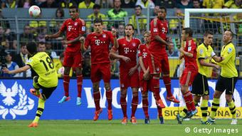 Nuri Sahin of Dortmund shoots a free-kick over the wall of Bayern during the Bundesliga match between Borussia Dortmund and FC Bayern Muenchen at Signal Iduna Park on May 4, 2013 in Dortmund, Germany. (Photo: Christof Koepsel/Bongarts/Getty Images)