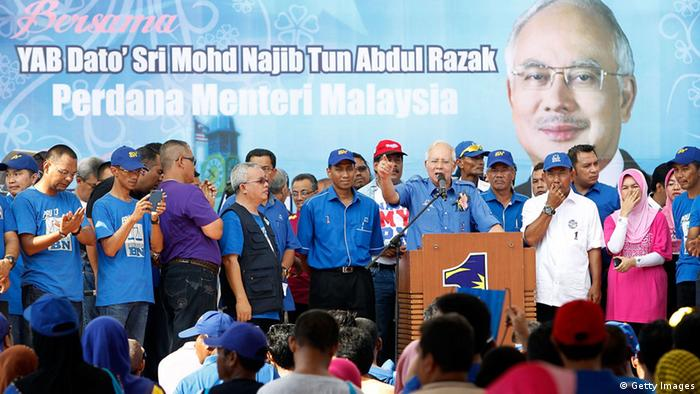 KUALA LUMPUR, MALAYSIA - MAY 04: Malaysia's Prime Minister and Barisan Nasional (BN) chairman Najib Razak greets supporters during an election rally to address young parliamentary constituency voters at his hometown on May 4, 2013 in Pekan, Malaysia. The election, set for May 5, will see incumbent PM Najib Razak face Anwar Ibrahim, whose opposition coalition includes moderates, Islamists and Malaysians of Chinese descent (Photo by Nicky Loh/Getty Images)