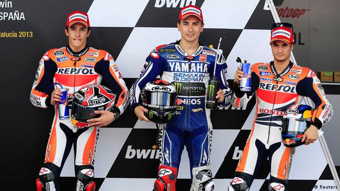 Yamaha MotoGP rider Jorge Lorenzo (C) of Spain poses for pictures with Honda's Dani Pedrosa (R) of Spain and Honda's Marc Marquez of Spain after taking the pole position during the Spanish Grand Prix in Jerez de la Frontera, southern Spain May 4, 2013. REUTERS/Marcelo del Pozo (SPAIN - Tags: SPORT MOTORSPORT)