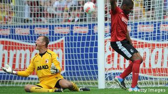 Cedrick Makiadi of Freiburg (R) celebrates after scoring the opening goal against goalkeeper Alexander Manninger of Augsburg during the Bundesliga match between SC Freiburg and FC Augsburg at MAGE SOLAR Stadium on May 5, 2013 in Freiburg, Germany. (Photo: Michael Kienzler/Bongarts/Getty Images)