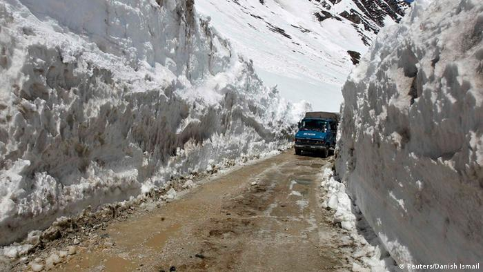 A vehicle plies between walls of snow after the Srinagar-Leh highway opened to traffic in Zojila, 108 km (67 miles) east of Srinagar April 6, 2013. The 443 km-long highway was opened by Indian army authorities for traffic on Saturday after remaining snowbound at Zojila Pass, 3,530 metres (11,581 feet) above sea level, for the past six months. The pass connects Kashmir with the Buddhist-dominated Ladakh region, a tourist destination known for its monasteries, landscapes and mountains. REUTERS/Danish Ismail (INDIAN-ADMINISTERED KASHMIR - Tags: ENVIRONMENT TRANSPORT TRAVEL)