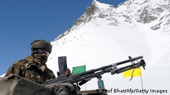 An Indian army solider guards the Srinagar-Leh highway in Zojila Pass about 108 kms, 67 miles, east of Srinagar on April 6, 2013.