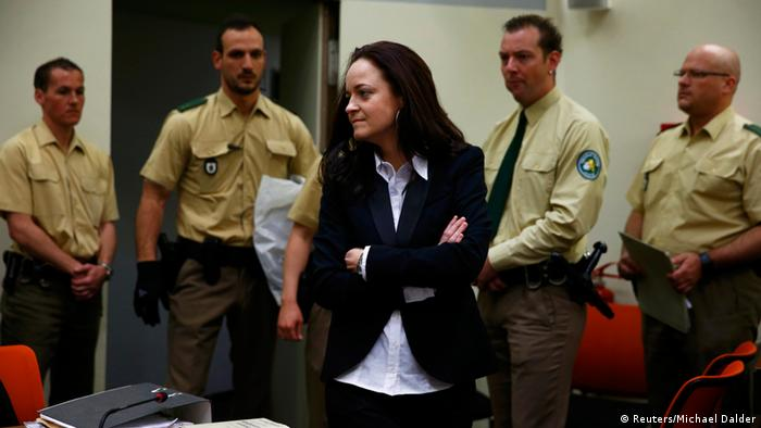 FREI FÜR SOCIAL MEDIA Beate Zschaepe (C), a member of the neo-Nazi group National Socialist Underground (NSU) stands in the court before the start of her trial in Munich May 6, 2013. The surviving member of NSU blamed for a series of racist murders that scandalised Germany and shamed its authorities goes on trial on Monday in one of the most anticipated court cases in recent German history. The trial in Munich will focus on 38-year-old Zschaepe, who is charged with complicity in the murder of eight Turks, a Greek and a policewoman between 2000-2007, as well as two bombings in immigrant areas of Cologne, and 15 bank robberies. REUTERS/Michael Dalder (GERMANY - Tags: POLITICS CRIME LAW)