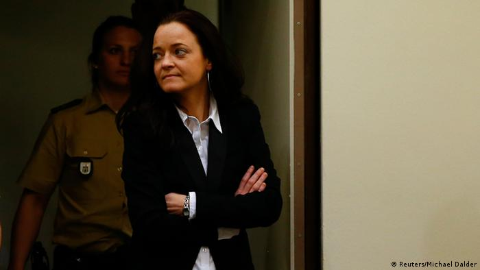 Beate Zschaepe, a member of the neo-Nazi group National Socialist Underground (NSU) enters the court before the start of her trial in Munich May 6, 2013. The surviving member of NSU blamed for a series of racist murders that scandalised Germany and shamed its authorities goes on trial on Monday in one of the most anticipated court cases in recent German history. The trial in Munich will focus on 38-year-old Zschaepe, who is charged with complicity in the murder of eight Turks, a Greek and a policewoman between 2000-2007, as well as two bombings in immigrant areas of Cologne, and 15 bank robberies. REUTERS/Michael Dalder (GERMANY - Tags: POLITICS CRIME LAW)