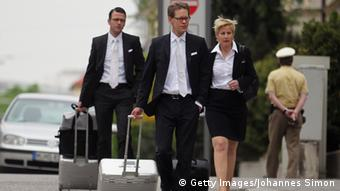 MUNICH, GERMANY - MAY 06: Wolfgang Heer, Wolfgang Stahl and Anja Sturm, who are the lawyers representing defendant Beate Zschaepe, arrive at the Oberlandesgericht Oberlandesgericht Muenchen state court on the first day of the NSU neo-Nazi murder trial on May 6, 2013 in Munich, Germany. The main defendant, Beate Zschaepe, is on trial for her role in assisting Uwe Boehnhardt and Uwe Mundlos in the murder of nine immigrants and one policewoman across Germany between 2000 and 2007, and four other co-defendants, including Ralf Wohlleben, Holder G., Carsten S. and Andre E., are accused of assisting the trio. Zschaepe, Mundlos and Boehnhardt lived together for years undetected by police and called themselves the National Socialist Underground, or NSU. The case only came to light after Mundlos and Boehnhardt committed suicide after the two were cornered by police following a bank robbery in 2011. (Photo by Johannes Simon/Getty Images)