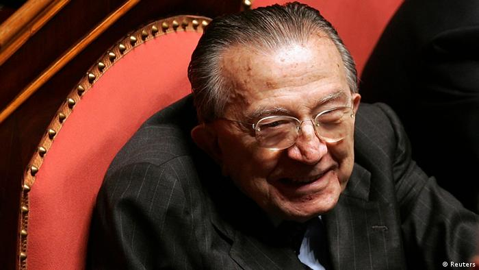 Italian Senator for life Giulio Andreotti smiles at the Senate as he waits to vote for the new Senate speaker in Rome in this April 28, 2006 file photo. Andreotti, seven times Italian prime minister and one of the country's most prominent post-war figures, has died at the age of 94, family sources said on May 6, 2013. REUTERS/Max Rossi/Files (ITALY - Tags: POLITICS OBITUARY)