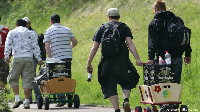 Men on a FAthers Day outing with two handcarts. Photo: Frank May (dpa)