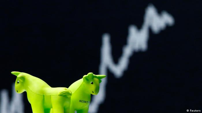 Bull figures are pictured in front of the German share price index DAX board at the German stock exchange in Frankfurt (Photo: REUTERS/Lisi Niesner)