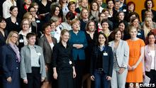 German Chancellor Angela Merkel (C) poses for a group picture with participants of a conference for women in executive positions at the Chancellery in Berlin, May 7, 2013 REUTERS/Fabrizio Bensch (GERMANY - Tags: BUSINESS EMPLOYMENT POLITICS)