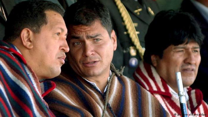 Ecuadorian Rafael Correa talking to Venezuelan President Hugo Chavez, with Bolivian President Evo Morales beside them, in the Andean town of Zumbahua, Ecuador, January 2007