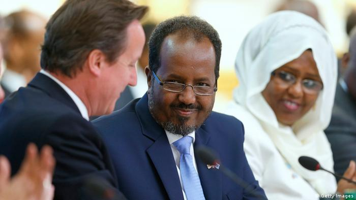 LONDON, UNITED KINGDOM - MAY 7: Prime Minister David Cameron (L) and Somali President Hassan Sheikh Mohamud (C) shake hands after making their opening speeches during the Somali conference, on May 7, 2013 in London, England. The international conference aims to help rebuild the east African country after more more than two decades of conflict. (Photo by Andrew Winning - WPA Pool/Getty Images)