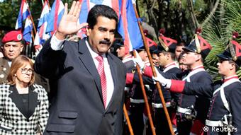 Venezuela's President Nicolas Maduro waves after arriving for a meeting with his Uruguayan counterpart Jose Mujica at the Uruguayan presidential house in Montevideo May 7, 2013