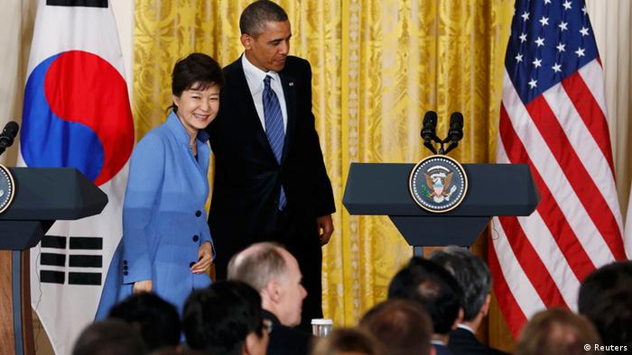 Barack Obama and South Korea's President Park Geun-hye depart a joint news conference in in Washington, May 7, 2013. REUTERS/Kevin Lamarque
