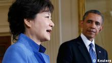 South Korea's President Park Geun-hye (L) addresses a joint news conference as U.S. President Barack Obama (R) listens in the East Room of the White House in Washington, May 7, 2013. REUTERS/Jason Reed (UNITED STATES - Tags: POLITICS)