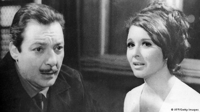 Picture from 1970 shows Egyptian mega stars Rushdi Abaza (1927-1980) and Suad Hosni (R) in a shot from the film Ghuroub wa Shurouq. Rushdie Abaza, considered the Casanova of Egyptian cinema, played in about 150 films since the beginning of his career in 1948. Suad Hosni, 58, also one of the most popular stars of her times until she gave up acting for health reasons in the mid-80s, acted in some 100 films. (Photo credit should read -/AFP/Getty Images)