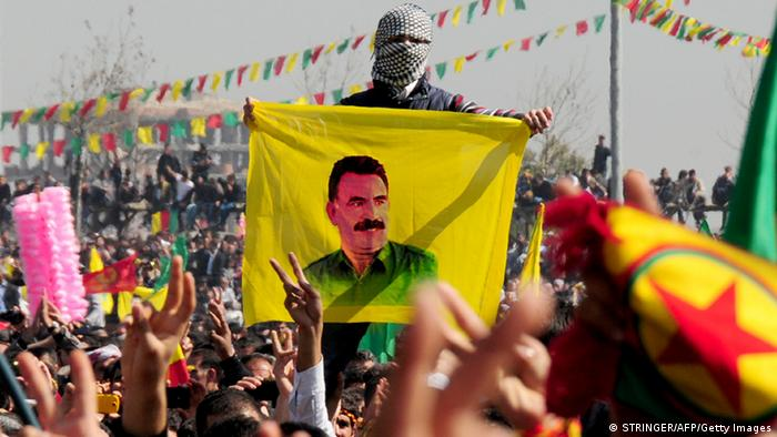 A Kurd celebrates on March 21, 2013 Nowruz, the Persian New Year festival, with a flag bearing a portrait of jailed Kurdish rebel chief Abdullah Ocalan in the southern Turkish city of Diyarbakir. The festival is celebrated in Turkey, Central Asian republics, Iraq, Iran, Azerbaijan as well as war-torn Afghanistan and coincides with the astronomical vernal equinox. Ocalan called on March 21 for a ceasefire, telling militants to lay down their arms and withdraw from Turkish soil, raising hopes for an end to a three-decade conflict with Turkey that has cost tens of thousands of lives. Turkish Prime Minister Recep Tayyip Erdogan responded cautiously to the much-anticipated announcement by saying Turkey would end military operations against Ocalan's outlawed Kurdistan Workers' Party (PKK) if militants halt their attacks. AFP PHOTO / STRINGER (Photo credit should read STRINGER/AFP/Getty Images)