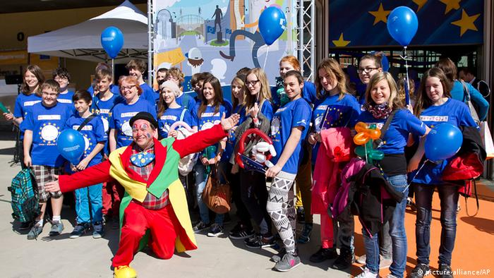 A school group of Austrian students pose for a photograph outside of EU headquarters in Brussels on Saturday, May 4, 2013. Once a year EU institutions open their doors and provide a local fair in which EU countries can display their local culture to the general public. (AP Photo/Virginia Mayo)