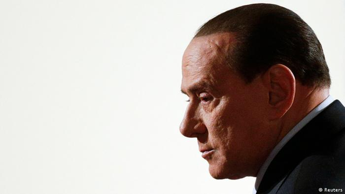 Former Italian Prime Minister Silvio Berlusconi arrives for a political rally in downtown Rome in this January 25, 2013 file photo. The Italian appeals court sentences Berlusconi to 4 years in jail in the Mediaset TV rights case on May 8, 2013. REUTERS/Max Rossi/Files (ITALY - Tags: POLITICS CRIME LAW)