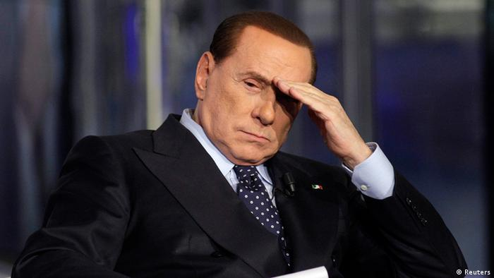 taly's former Prime Minister Silvio Berlusconi gestures as he appears as a guest on the RAI television show Porta a Porta (Door to Door) in Rome in this February 20, 2013 file photo. A Milan appeals court confirmed the sentencing of Berlusconi to 4 years in jail on May 8, 2013 for tax fraud in connection with the purchase of broadcasting rights by his television network Mediaset. REUTERS/Remo Casilli/Files (ITALY - Tags: POLITICS CRIME LAW)