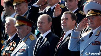Russian President Vladimir Putin (3rd R) and Prime Minister Dmitry Medvedev (2nd R) watch the Victory Parade on Moscow's Red Square May 9, 2013. (Photo: REUTERS/Sergei Karpukhin)