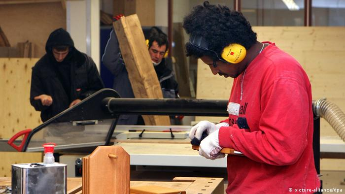 Youth at Seehaus prison alternative doing wood shop work
