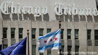 CHICAGO, IL - JUNE 07: A Chicago and a NATO flag fly over the Michigan Avenue bridge near the Tribune Tower, headquarters of the Tribune Company, on June 7, 2012 in Chicago, Illinois. The Tribune Company, owner of the Chicago Tribune, Los Angeles Times and several broadcasting outlets across the country, returns to court today to face one of the final hurdles before possibly exiting bankruptcy. (Photo by Scott Olson/Getty Images)
