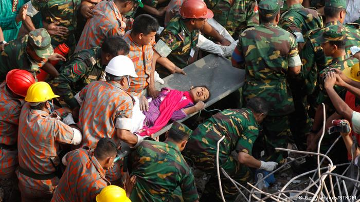 Bangladeshi rescuers retrieve garment worker Reshma from the rubble of a collapsed building in Savar on May 10, 2013, seventeen days after the eight-storey building collapsed. The death toll from last month's collapse of a garment factory complex in Bangladesh rose past 1,000 as piles of bodies were found in the ruins of a stairwell where victims had sought shelter. AFP PHOTO/STR (Photo credit should read STRDEL/AFP/Getty Images)