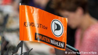 Symbolic photo of Germany's Pirate Party logo on an orange flag Photo: Armin Weigel/dpa +++(c) dpa - Bildfunk+++