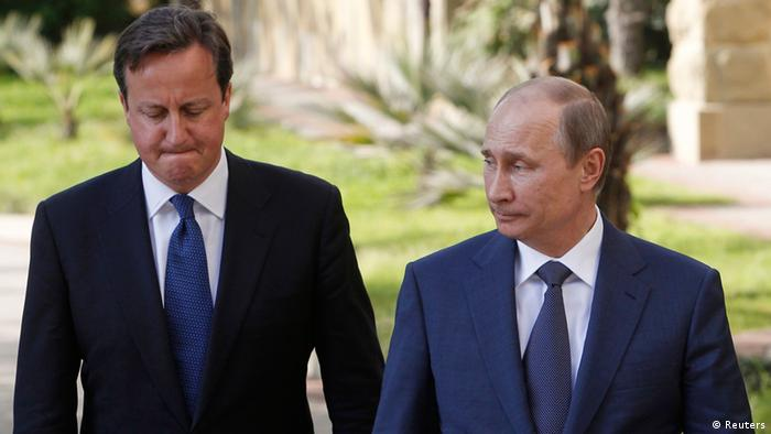 Russian President Vladimir Putin (R) and Britain's Prime Minister David Cameron arrive to address the media after their meeting at the Bocharov Ruchei state residence in Sochi May 10, 2013. REUTERS/Sergei Karpukhin (RUSSIA - Tags: POLITICS)