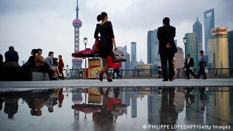 Pedestrian in front of Shanghai's skyline. Photo: AFP PHOTO/Philippe Lopez
