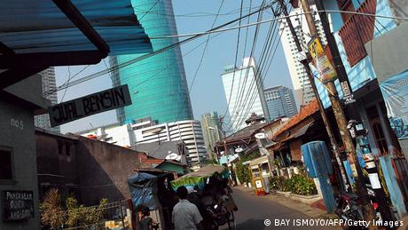 A busy street in Jakarta with skyscrapers visible in the background. Photo: AFP PHOTO / Bay ISMOYO