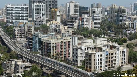 A Mumbai Metro train passes through a residential area during its first official safety trial run in Mumbai (Getty Images)