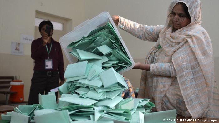 A Pakistani election official empties a ballot box at the end of polling in Islamabad on May 11, 2013 (Photo: AAMIR QURESHI/AFP/Getty Images)
