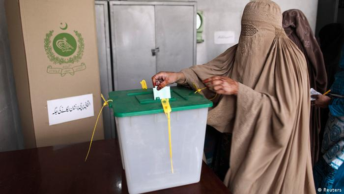 A woman casts her vote at a polling station on the outskirts of Islamabad May 11, 2013. A string of militant attacks cast a long shadow over Pakistan's general election on Saturday, but millions still turned out to vote in a landmark test of the troubled country's democracy. REUTERS/Zohra Bensemra (PAKISTAN - Tags: POLITICS ELECTIONS)