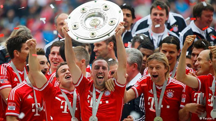 Bayern Munich's Franck Ribery lifts up the trophy as his team celebrates after their German first division Bundesliga soccer match against Augsburg in Munich, May 11, 2013. REUTERS/Kai Pfaffenbach
