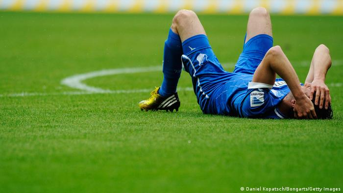 David Abraham of Hoffenheim lies on the pitch