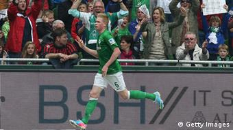 Kevin De Bruyne of Bremen celebrates his goal during the Bundesliga match between Werder Bremen and Eintracht Frankfurt at Weser Stadium on May 11, 2013 in Bremen, Germany. (Photo by Lars Kaletta/Bongarts/Getty Images)