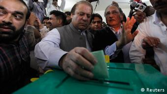 Nawaz Sharif (C), leader of the Pakistan Muslim League - Nawaz (PML-N) political party, casts his vote for the general election at a polling station in Lahore May 11, 2013 (Photo: REUTERS/Mohsin Raza)
