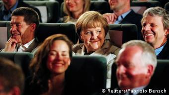 German Chancellor Angela Merkel (center), her husband Joachim Sauer (left) and German film director Andreas Dresen