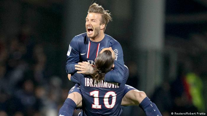 Paris Saint-Germain's Zlatan Ibrahimovic and David Beckham celebrate at the end of their team's French Ligue 1 soccer match against Olympique Lyon at the Gerland stadium in Lyon May 12, 2013. Paris Saint-Germain secured the French Ligue 1 soccer Championships title after beating Olympique Lyon 0-1 on Sunday in Lyon. REUTERS/Robert Pratta (FRANCE - Tags: SPORT SOCCER TPX IMAGES OF THE DAY)